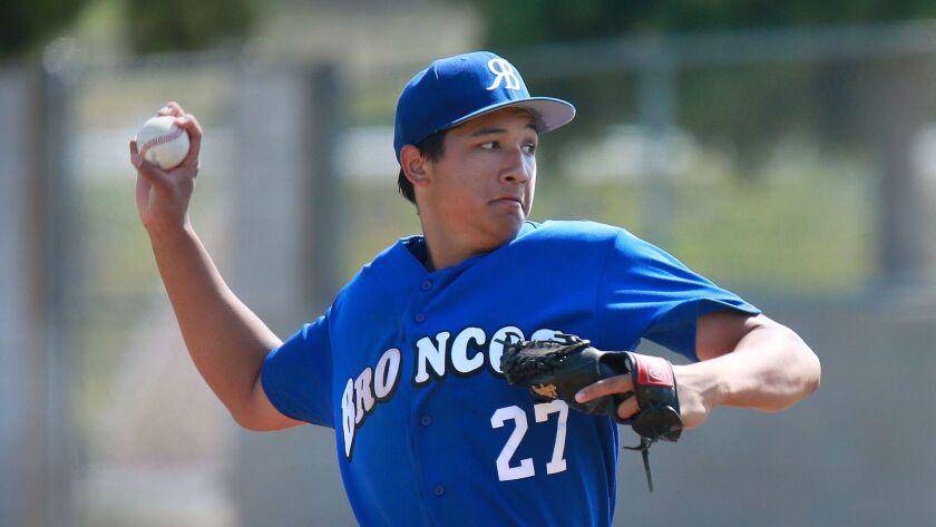 Rancho Bernardo pitcher Mason Pelio delivers against Granite Hills.