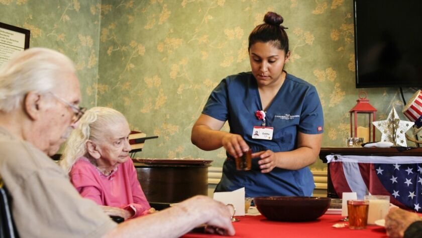 Nursing assistant Gabby Carrillo works at a nursing home in Pasadena. California's healthcare and educational services sector grew 2.9% year over year.
