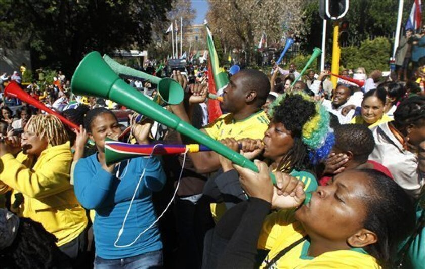 Hundreds of fans blowing their vuvuzelas in Johannesburg, South Africa, Wednesday, June 9, 2010. Nothing represents the sheer exuberance of South African soccer fans better than the vuvuzela, the trombone-length plastic horn that will be heard in force starting Friday at the World Cup. (AP Photo/Darko Vojinovic)