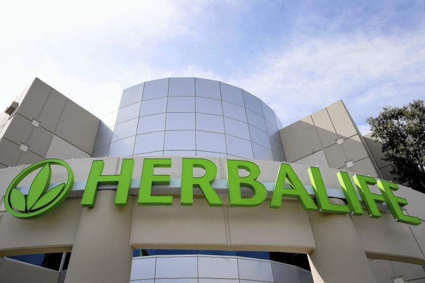 Federal prosecutors charged Herbalife with paying bribes to Chinese officials.