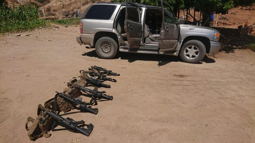 Gold SUV from California stopped by Mexican Army officials carried heavy arsenal of machine guns