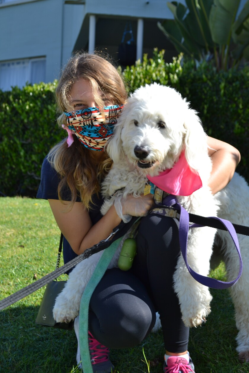 La Jolla dog walker Molly Ludwig is masked and ready.