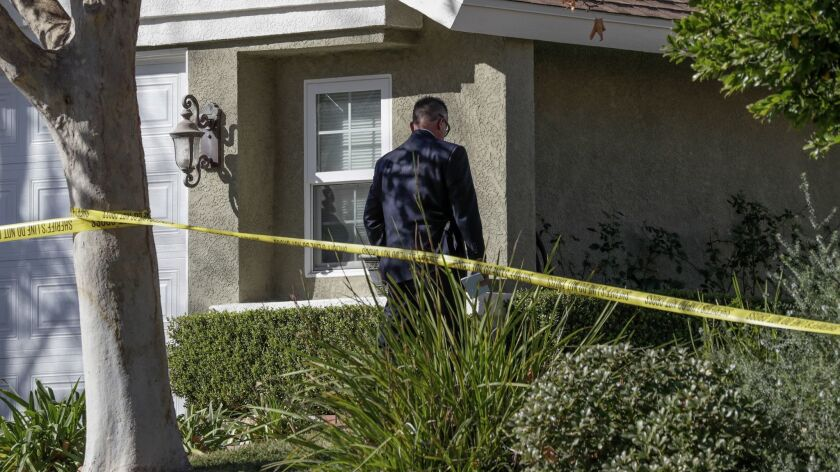 L.A. County Sheriff detectives and crime scene investigator at house on Startree Lane in Santa Clarita,where four people were found shot to death Friday.
