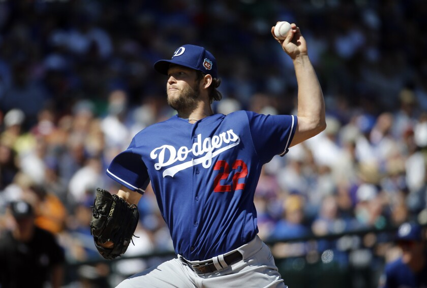 Dodgers starting pitcher Clayton Kershaw throws during the first inning of a spring training game against the Cubs.