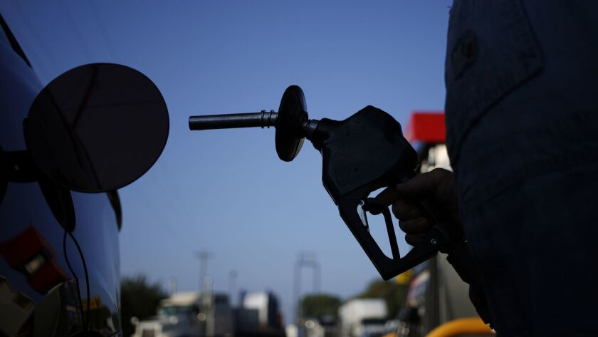 Gasoline prices have dropped by an average of 22 cents a gallon in the San Diego area in the past month and the trend may continue as crude oil prices continue to fall.