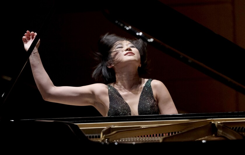 Pianist Yuja Wang will join the Los Angeles Philharmonic to perform a new work by composer John Adams.
