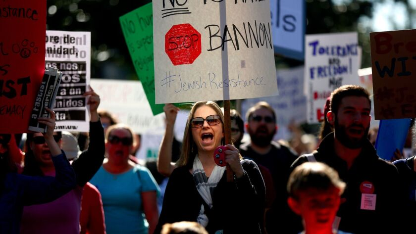 Allison Levine of Los Angeles joins protest marchers near the Breitbart News Network office on Wilshire Boulevard in Beverly Hills on Dec. 4.