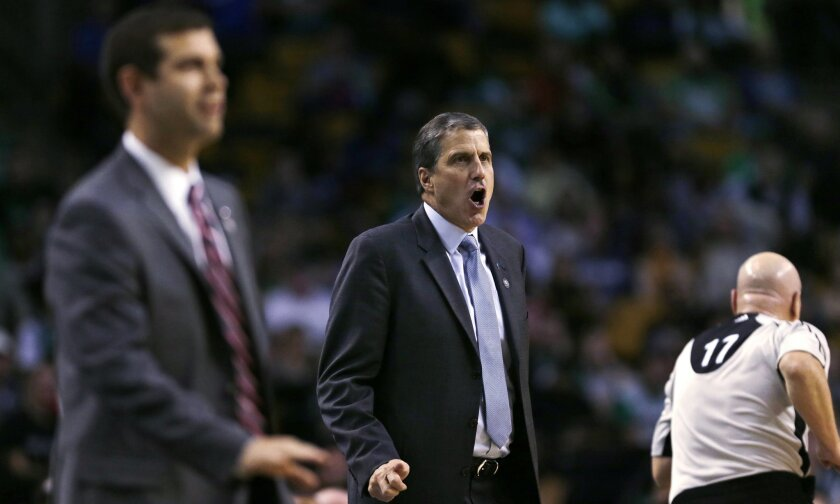 Washington Wizards head coach Randy Wittman, center, calls to his players during the first quarter of an NBA basketball game against the Boston Celtics in Boston, Friday, Nov. 6, 2015. (AP Photo/Charles Krupa)