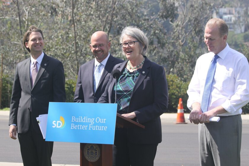 San Diego City Council President Sherri Lightner speaks about survey results, with director of performance and analytics Amis Udrys, Councilmember Scott Sherman and Mayor Kevin Faulconer.