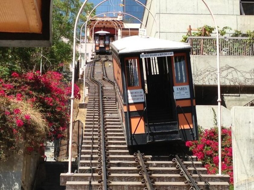 One of the Angels Flight funicular railway cars derailed Thursday and was left tilting on the rail platform.