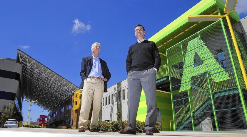 Developers Ned Fox, left, and Stuart Gulland in front of Playa Jefferson, their new office complex in the rapidly evolving planned community of Playa Vista.