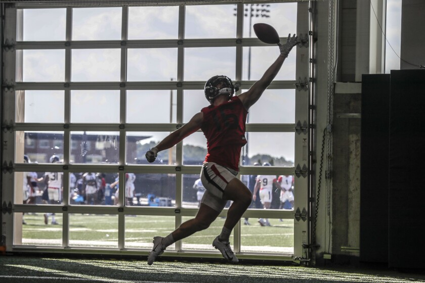 Tight end Chris Barrett makes a catch as the Liberty University football team practices at its indoor practice facility.