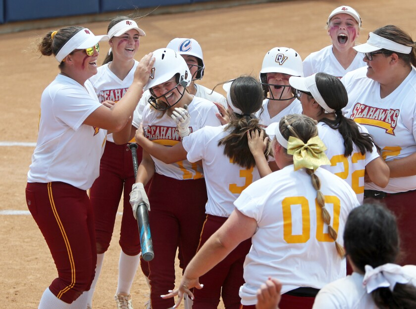 Ocean View sophomore Emma Craft, third from left, is mobbed by teammates after she scores the go-ahead run.