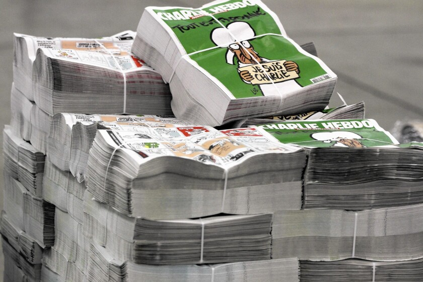 Copies of the upcoming edition of the French satirical magazine Charlie Hebdo are stacked at a distribution centre in Nantes, France, on Jan. 13, 2015.