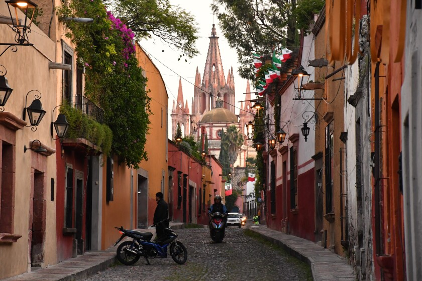 Calle Aldama, in the historic center of Mexico's San Miguel de Allende, includes cobblestones and views of La Parroquia church, whose towers date to the 19th century.