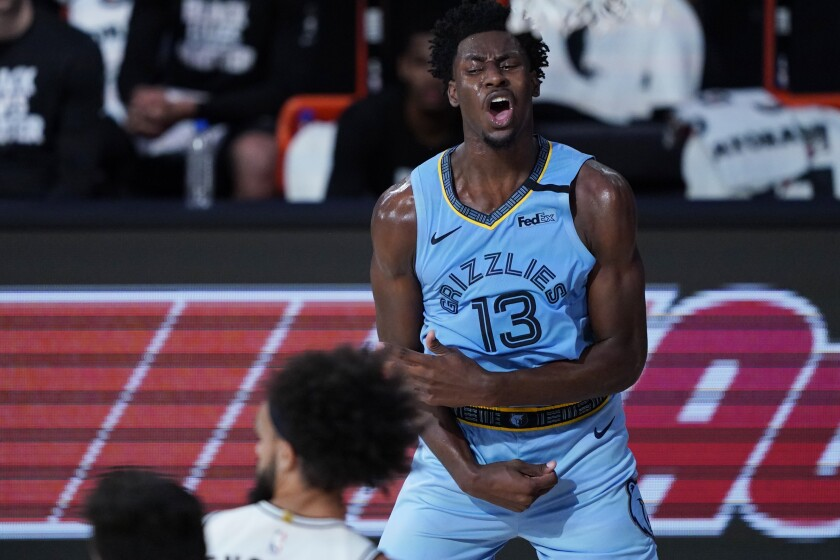 Memphis Grizzlies' Jaren Jackson Jr. (13) reacts after a play against the San Antonio Spurs during the second half of an NBA basketball game Sunday, Aug. 2, 2020, in Lake Buena Vista, Fla. (AP Photo/Ashley Landis, Pool)