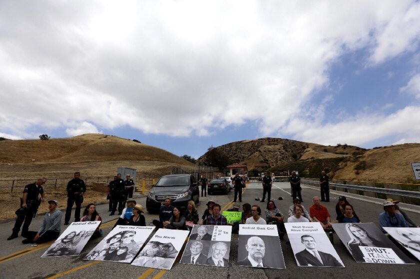 Protesters staged a sit-in Saturday at the entrance to Aliso Canyon natural gas storage facility in the hills above Porter Ranch.