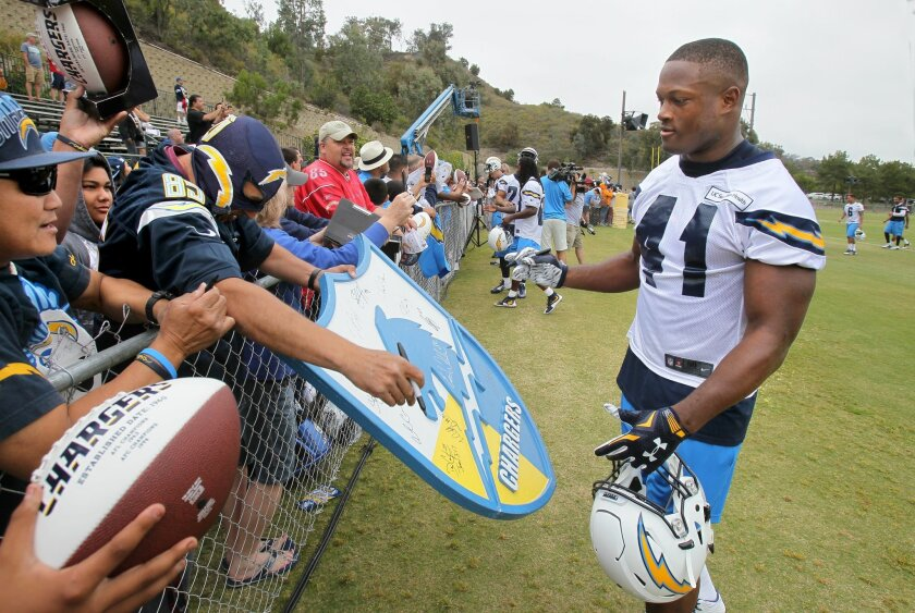 Fullback Chris Swain approaches fans after the practice session to sigh autographs.