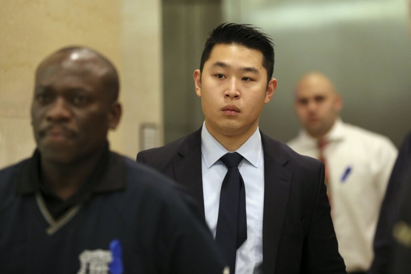 Police Officer Peter Liang, center, exits the courtroom during a break in closing arguments in his trial on charges in the shooting death of Akai Gurley, Tuesday, Feb. 9, 2016, at Brooklyn Supreme court in New York.  Jurors are scheduled to start discussing their views of Liang's actions as soon as