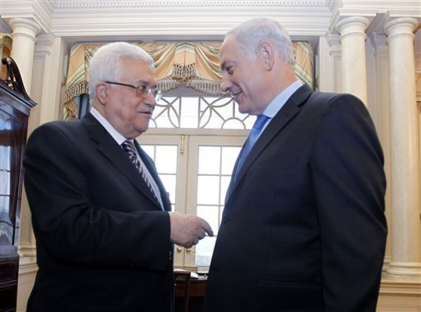 Israeli Prime Minister Benjamin Netanyahu talks with Palestinian President Mahmoud Abbas at the State Department in Washington, Thursday, Sept. 2, 2010, before attending their direct talks aimed at peace in the Middle East. (AP Photo/Jason Reed, Pool)