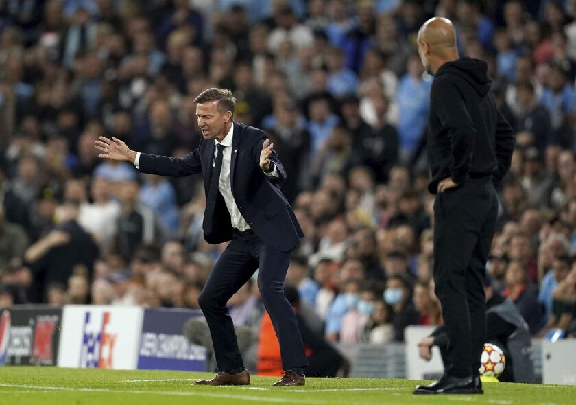 RB Leipzig manager Jesse Marsch, left, and Manchester City manager Pep Guardiola on the touchline during the Champions League Group A soccer match between Manchester City and RB Leipzig at the Etihad Stadium, Manchester, England, Wednesday Sept. 15, 2021. (Martin Rickett/PA via AP)