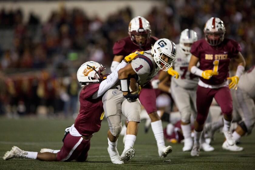 EAST LOS ANGELES, CA - Friday, Nov. 1 Garfield High School Bull Dogs Running Back P.J Garcia.