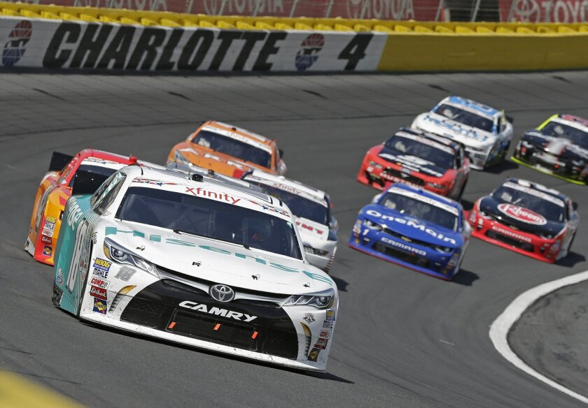 Denny Hamlin (18) leads cars out of Turn 4 during the NASCAR Xfinity series auto race at Charlotte Motor Speedway in Concord, N.C., Saturday, May 28, 2016. (AP Photo/Chuck Burton)