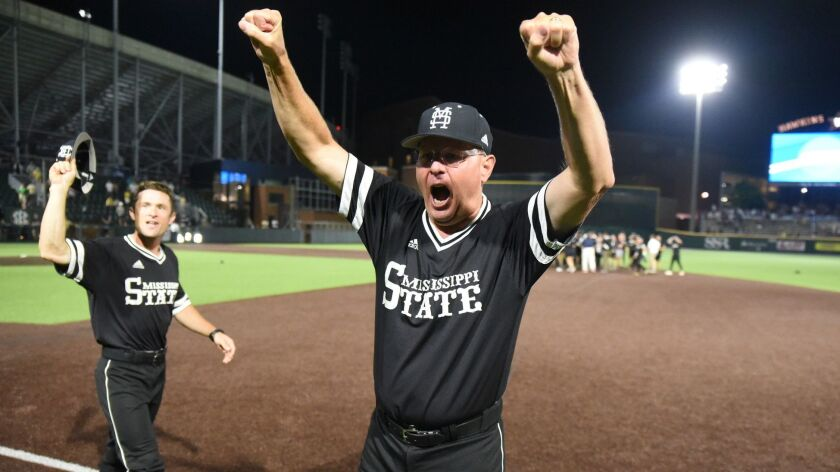 Mississippi State interim head coach Gary Henderson celebrates after beating Vanderbilt 10-6 in 11 innings, sending the Bulldogs to the College World Series.