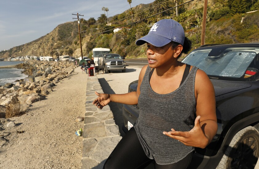 Nidia Greiss, 39, and her husband live out of their vehicle parked on Pacific Coast Highway at Las Tunas Beach in eastern Malibu.