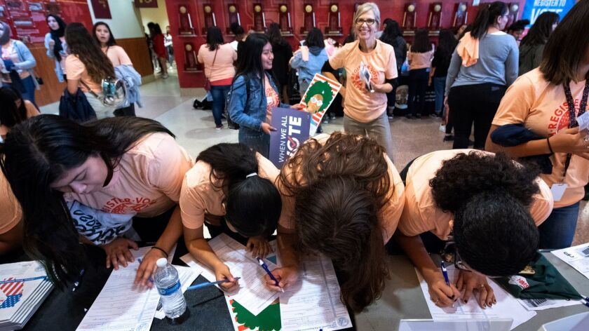 High school students preregister to vote at the Girls Build summit last month at USC.