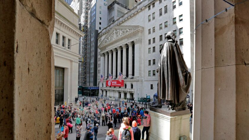 A statue of George Washington overlooks the New York Stock Exchange.