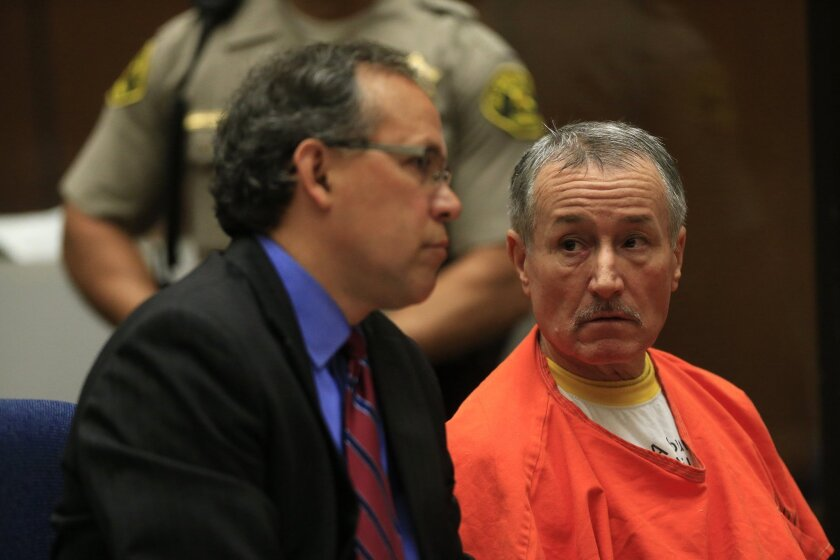 Former Miramonte Elementary School teacher Mark Berndt sits in court with his attorney, Manny Medrano, in November. Bernt pleaded no contest to 23 counts of lewd conduct with students. Lawmakers passed a measure Thursday that would speed the dismissal process for teachers accused of misconduct.