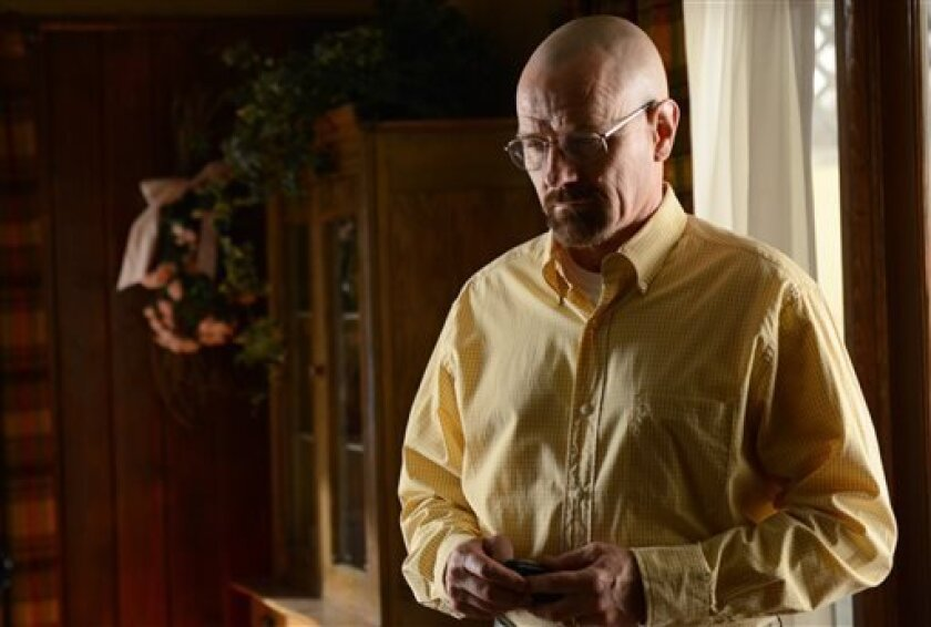 """This image provided by AMC shows Bryan Cranston as Walter White in a scene from """"Breaking Bad."""" More people are binge watching their favorite shows thanks to video streaming and On Demand services. For some, binging on TV shows and movies feels a whole lot like dating. (AP Photo/AMC, Ursula Coyote)"""