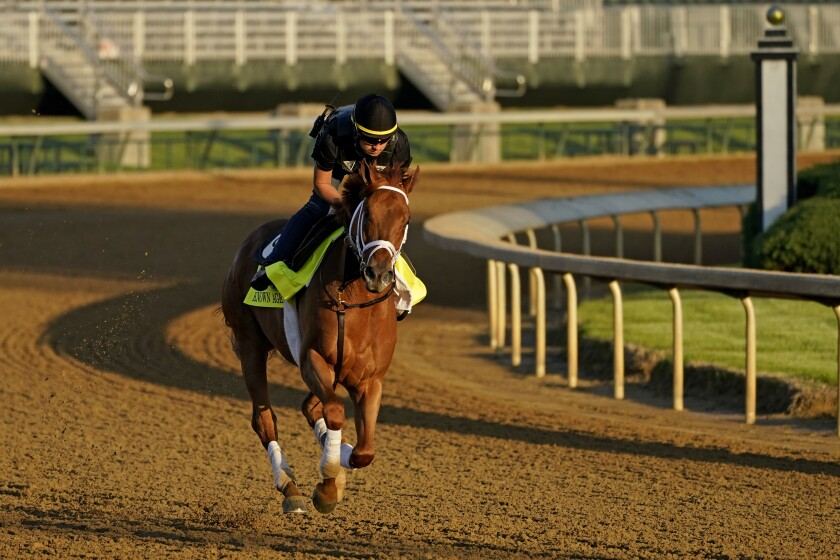Kentucky Derby hopeful Known Agenda works out at Churchill Downs Tuesday, April 27, 2021, in Louisville, Ky. The 147th running of the Kentucky Derby is scheduled for Saturday, May 1. (AP Photo/Charlie Riedel)