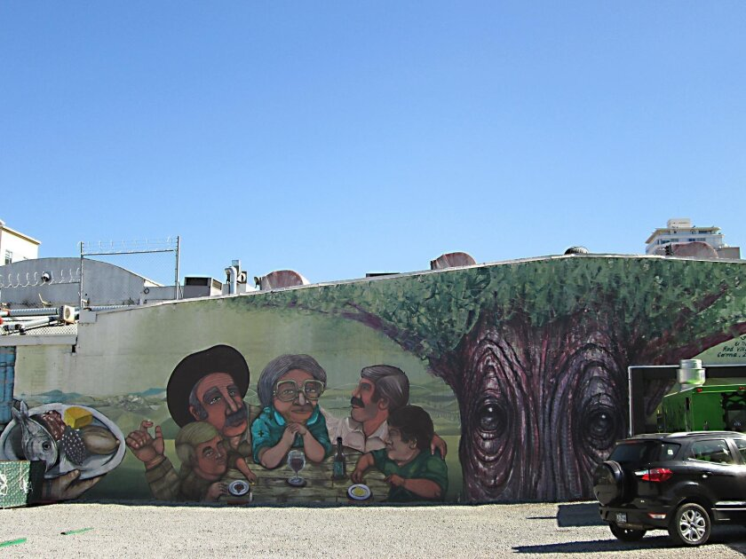 Mural in the restaurant parking lot next to Verde y Crema