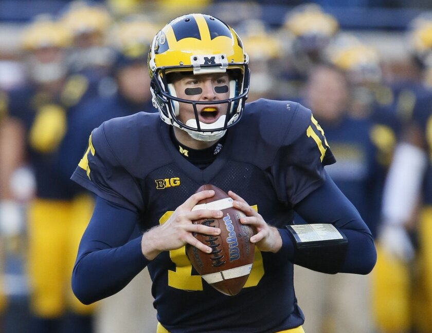 Michigan quarterback Jake Rudock looks to pass against Rutgers during the first half of an NCAA college football game Saturday, Nov. 7, 2015, in Ann Arbor, Mich. Rudock threw for two touchdowns and a career-high 337 yards in a 49-16 win over Rutgers. (AP Photo/Duane Burleson)