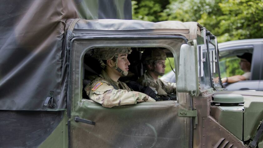 West Point cadets drive along Route 293 near the site where a a light medium tactical overturned, Th