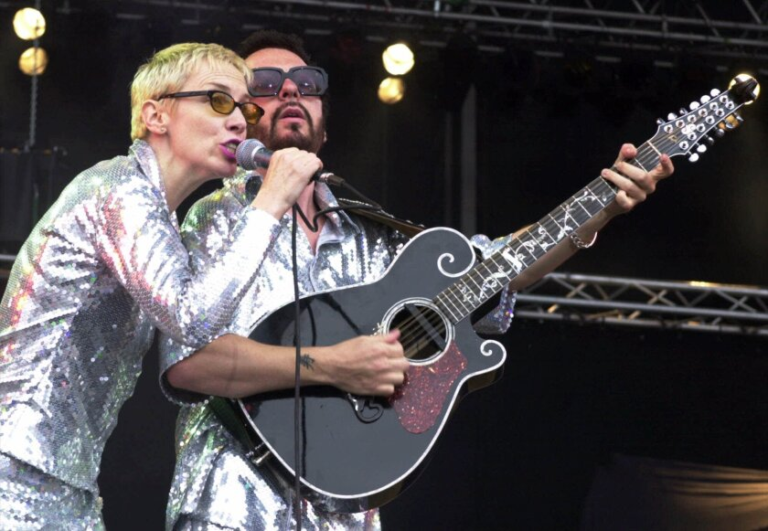 File- This June 10, 2000, file photo shows Annie Lennox, left, and Dave Stewart as the Eurythmics performing on stage at the Rock at the Ring three-day music festival at the Nuerburgring race circuit in Nuerburg, Germany.  The Eurythmics are reuniting to pay tribute to the Beatles. The Recording Ac
