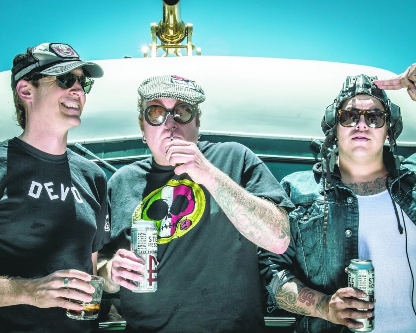 Sublime with Rome features former San Diego singer-guitarist Roman Ramirez (right), original Sublime bassist Eric Wilson (left) and drummer Josh Freese (left).