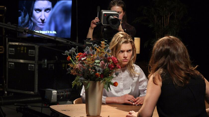 """Lacey Dorn as Elisabet, left, and Amanda Crider as Alma in the Los Angeles Opera production of Keeril Makan's """"Persona"""" at REDCAT."""