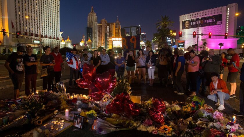 LAS VEGAS, NV - OCTOBER 4, 2017: A crowd gathers Wednesday night to pay tribute at a memorial for t