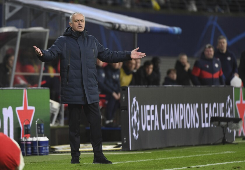 Tottenham coach Jose Mourinho gestures on the touchline during the Champions League round of 16, 2nd leg soccer match between RB Leipzig and Tottenham Hotspur in Leipzig, Germany, Tuesday, March 10, 2020. (Hendrik Schmidt/dpa via AP)