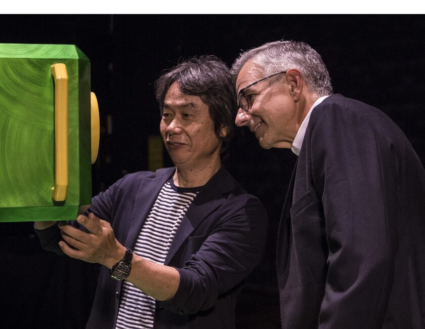 Nintendo Creative Fellow Shigeru Miyamoto, left, and Universal Creative President Mark Woodbury discuss their vision for what the new lands will hold.