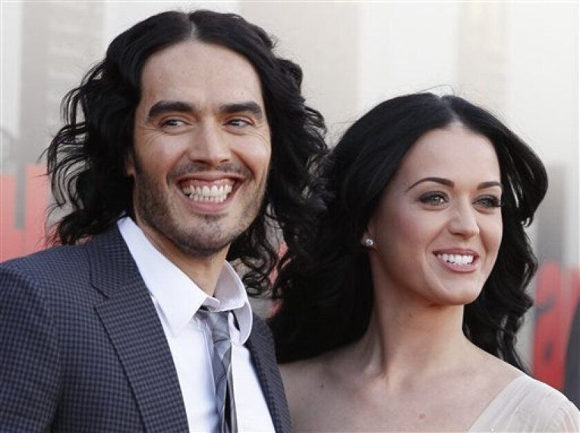 """FILE - In this April 19, 2011 file photo, British actor Russell Brand and his wife Katy Perry arrive for the European premiere of """"Arthur,"""" in London. A judge signed off on the couple's divorce Wednesday, but the pair will have to wait until July 14 until they are legally single again. Financial details of the split are confidential. (AP Photo/Joel Ryan, file)"""