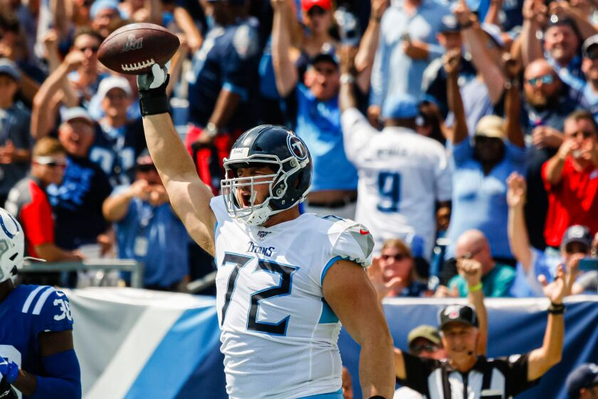 Tennessee Titans offensive tackle David Quessenberry celebrates after catching a touchdown against the Indianapolis Colts in the first half in Nashville on Sunday.