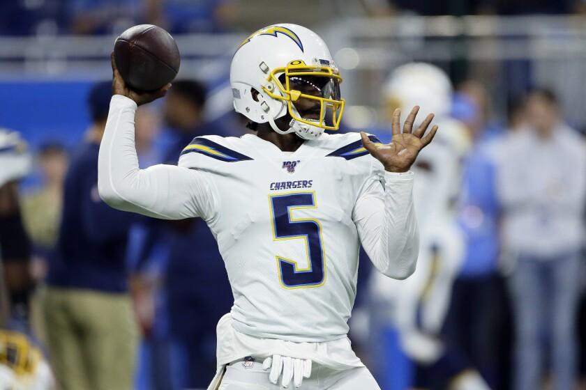 FILE - In this Sept. 15, 2019, file photo, Los Angeles Chargers quarterback Tyrod Taylor throws before an NFL football game against the Detroit Lions in Detroit. Coach Anthony Lynn is trying his best to quiet any doubts that Taylor will be the Chargers quarterback to start the season. (AP Photo/Duane Burleson, File)