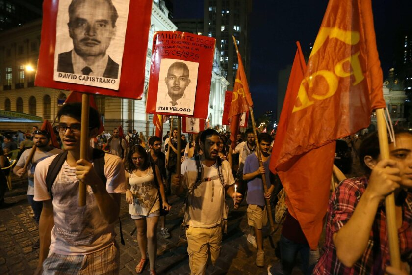 Demonstrators protest at the Military Club in Rio de Janeiro on the 50th anniversary of the coup d'etat against president Joao Goulart.