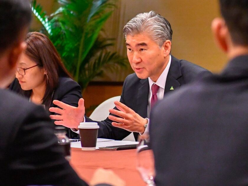U.S. envoy Sung Kim talks with members of the North Korean delegation during a working group.