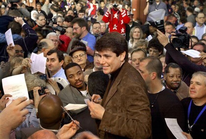 In this Sunday, Jan. 12, 2003 picture, Illinois Gov.-elect Rod Blagojevich signs autographs surrounded by a sea of supporters in Springfield, Ill., during an inauguration barbeque at the State Fairgrounds. Blagojevich was arrested this week on federal charges that he tried to sell President-elect Barack Obama's vacant Senate seat. (AP Photo/Seth Perlman)