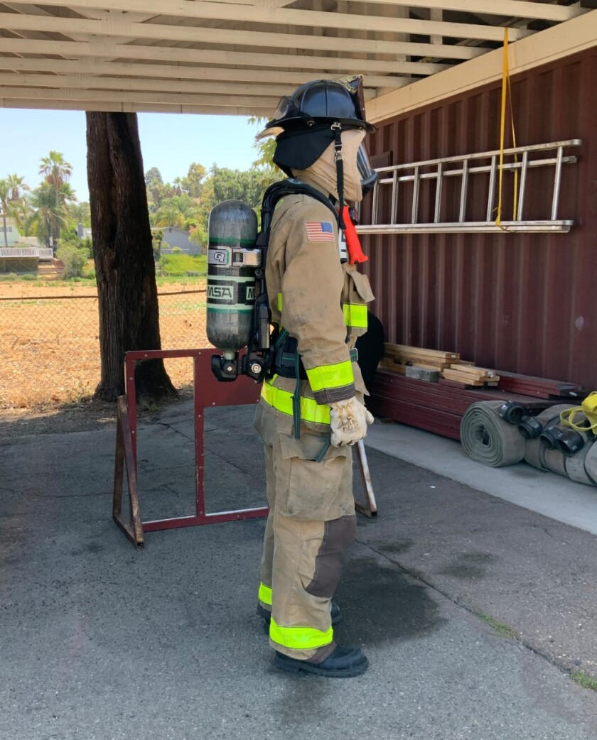 A Bonita firefighter shows the type of breathing apparatus